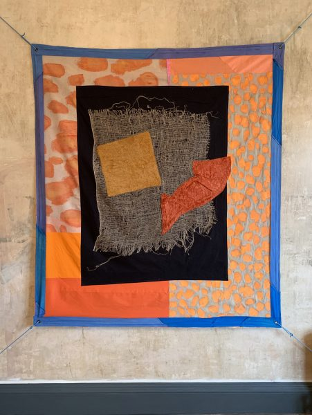 A hanging patchwork quilt